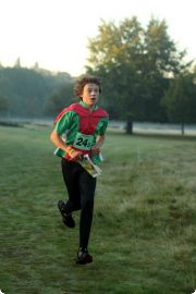 Alastair Gardner-Smith completing his relay leg,