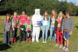 The Peter Palmer relay team posing with rabbit,